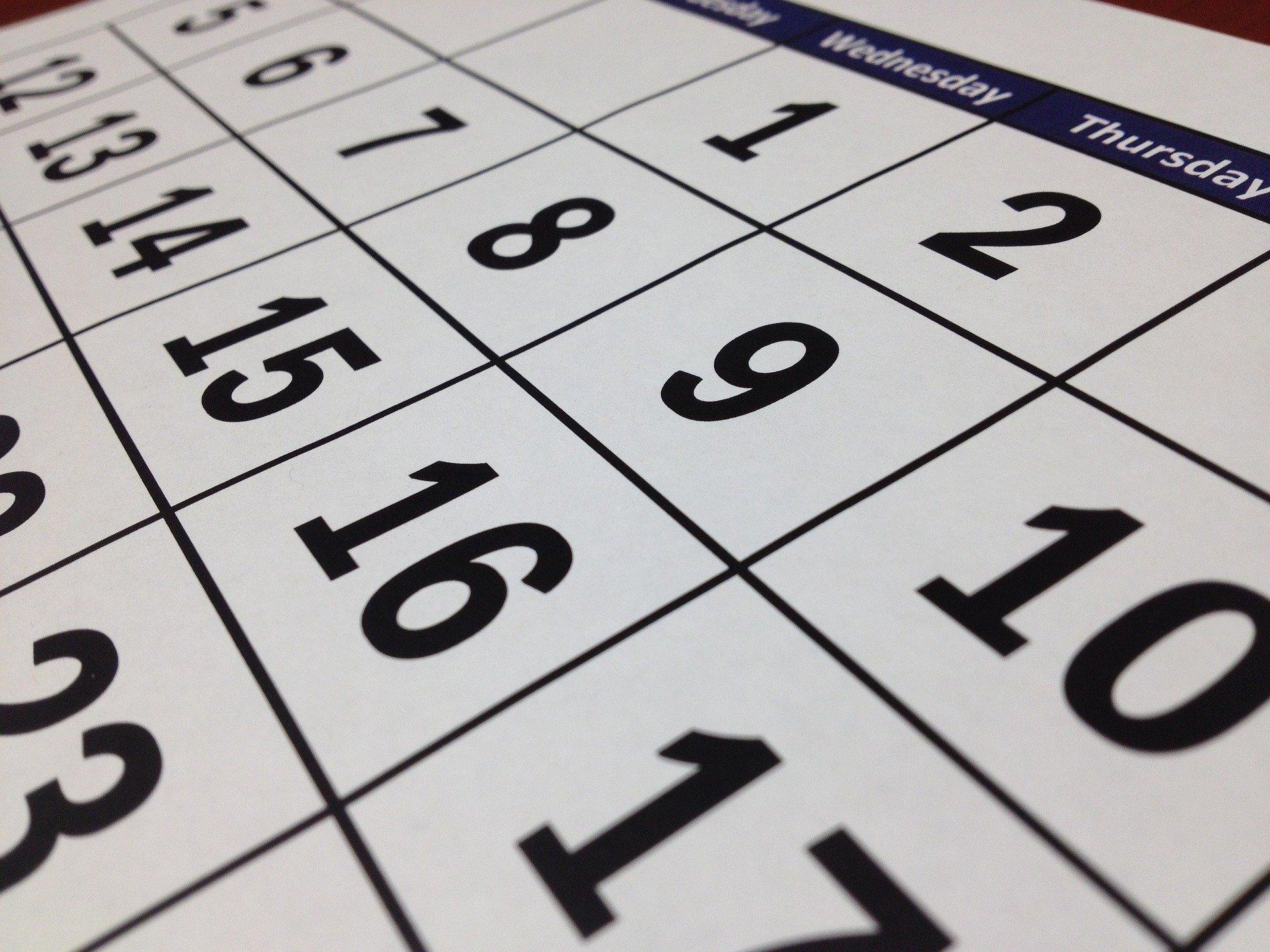 Close up of a large calendar.