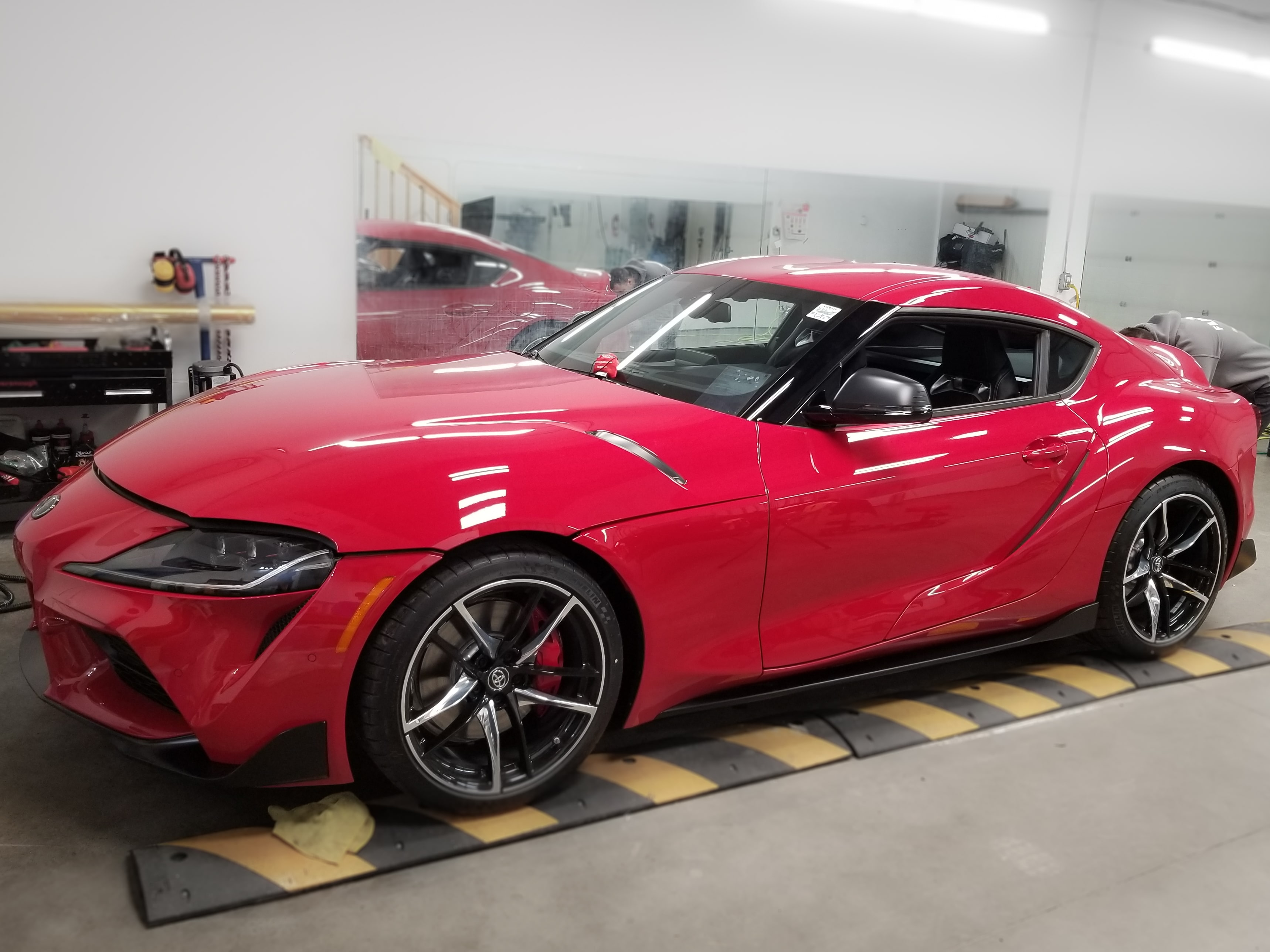 The Toyota Supra before vinyl wrap, it is red.