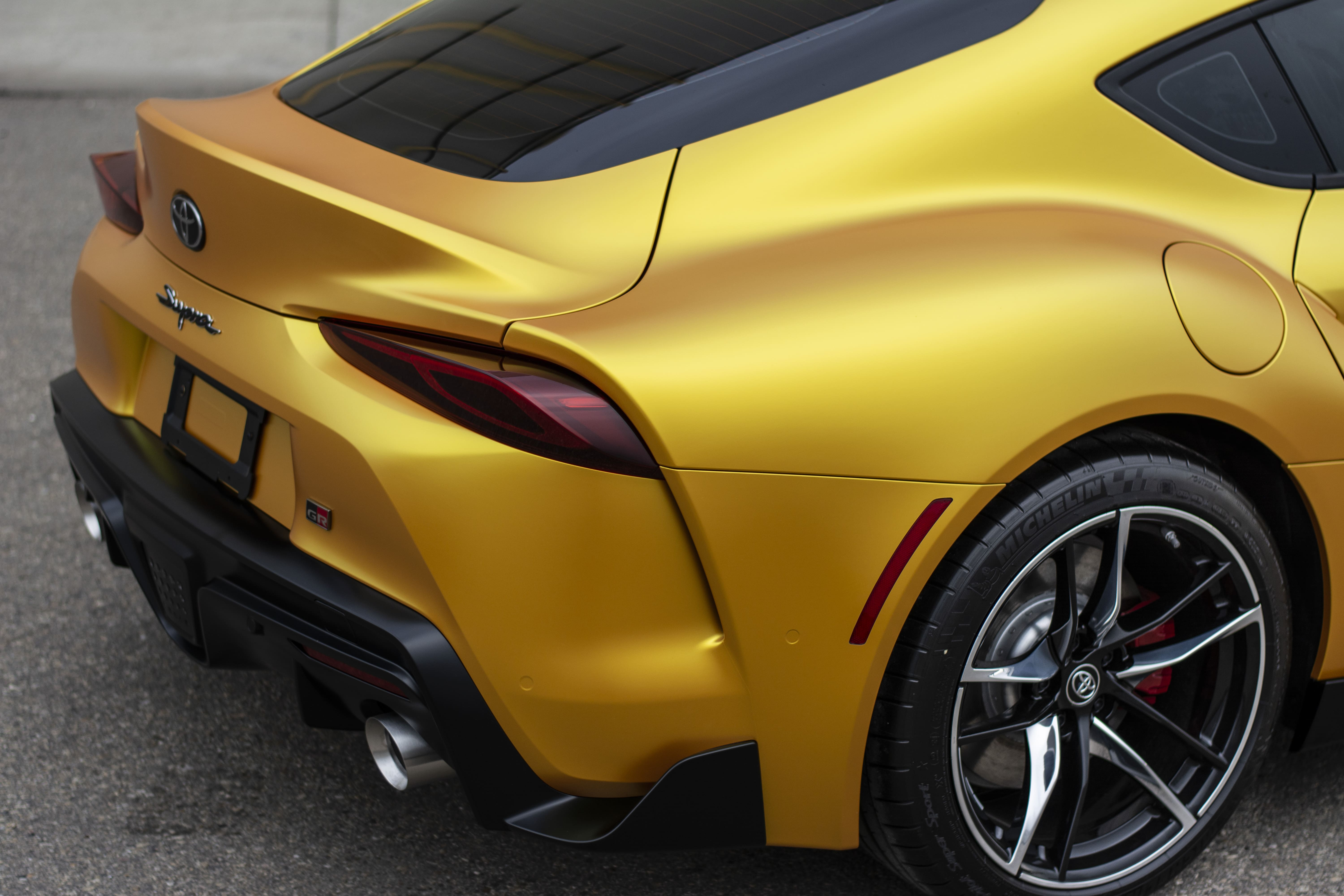 Another  image of the Toyota Supra's back end wrapped.