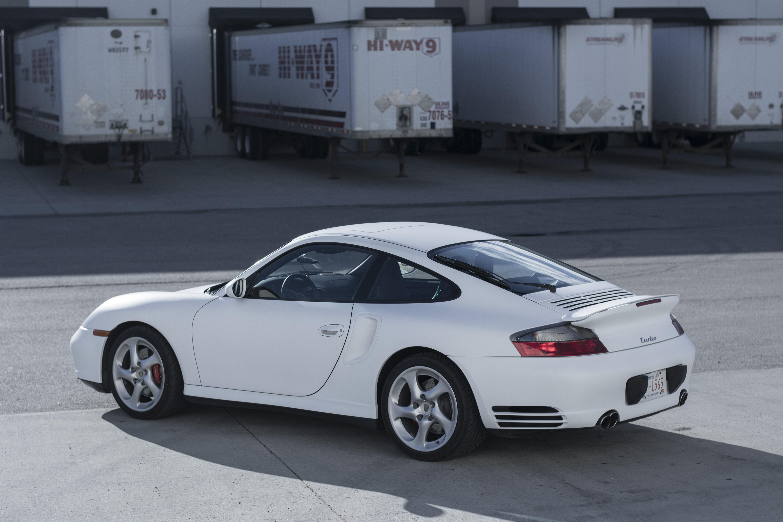 Vinyl wrapped white Porsche.