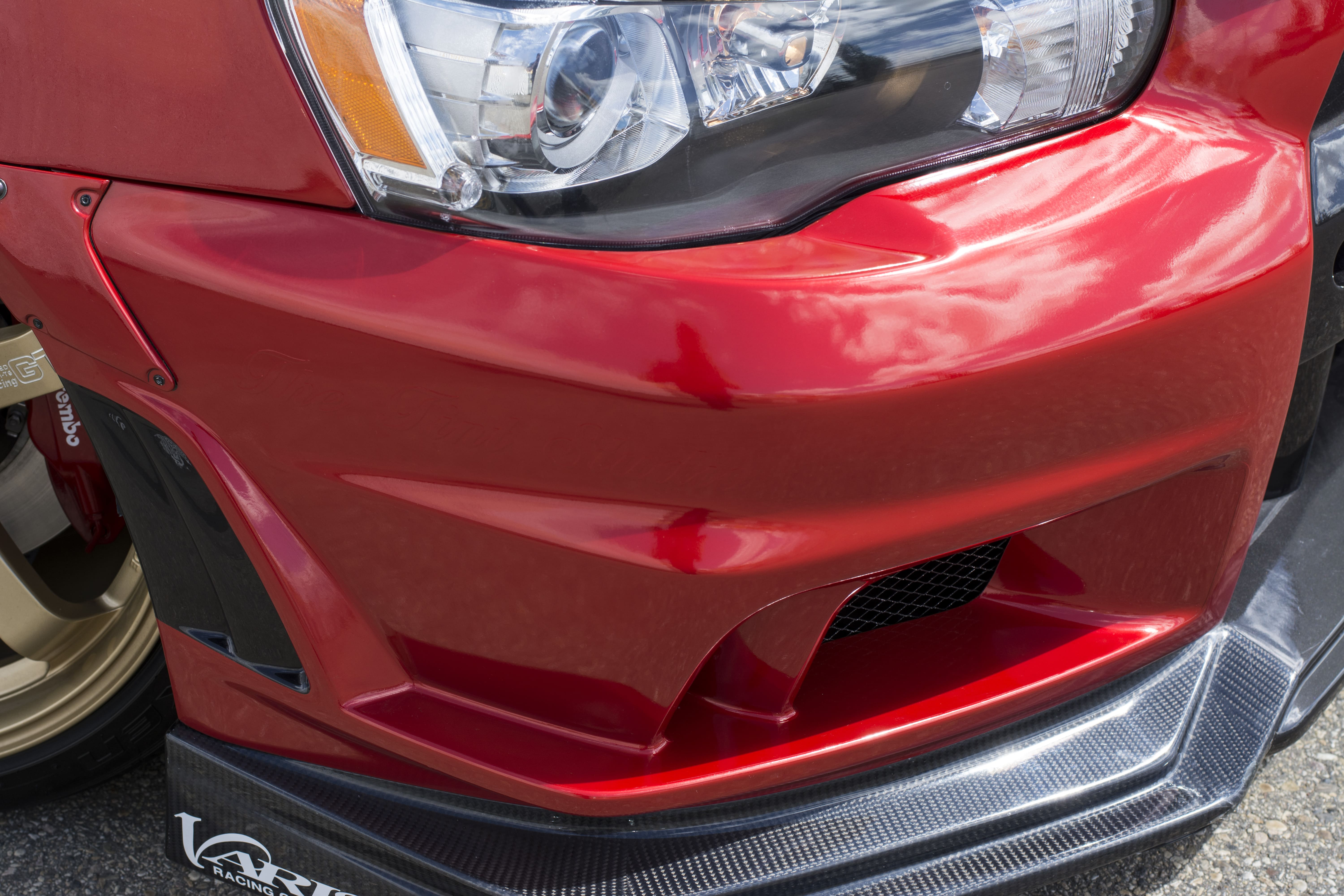 Mitsubishi Lancer Evo with Dragon Fire Red, image of front end bumper.