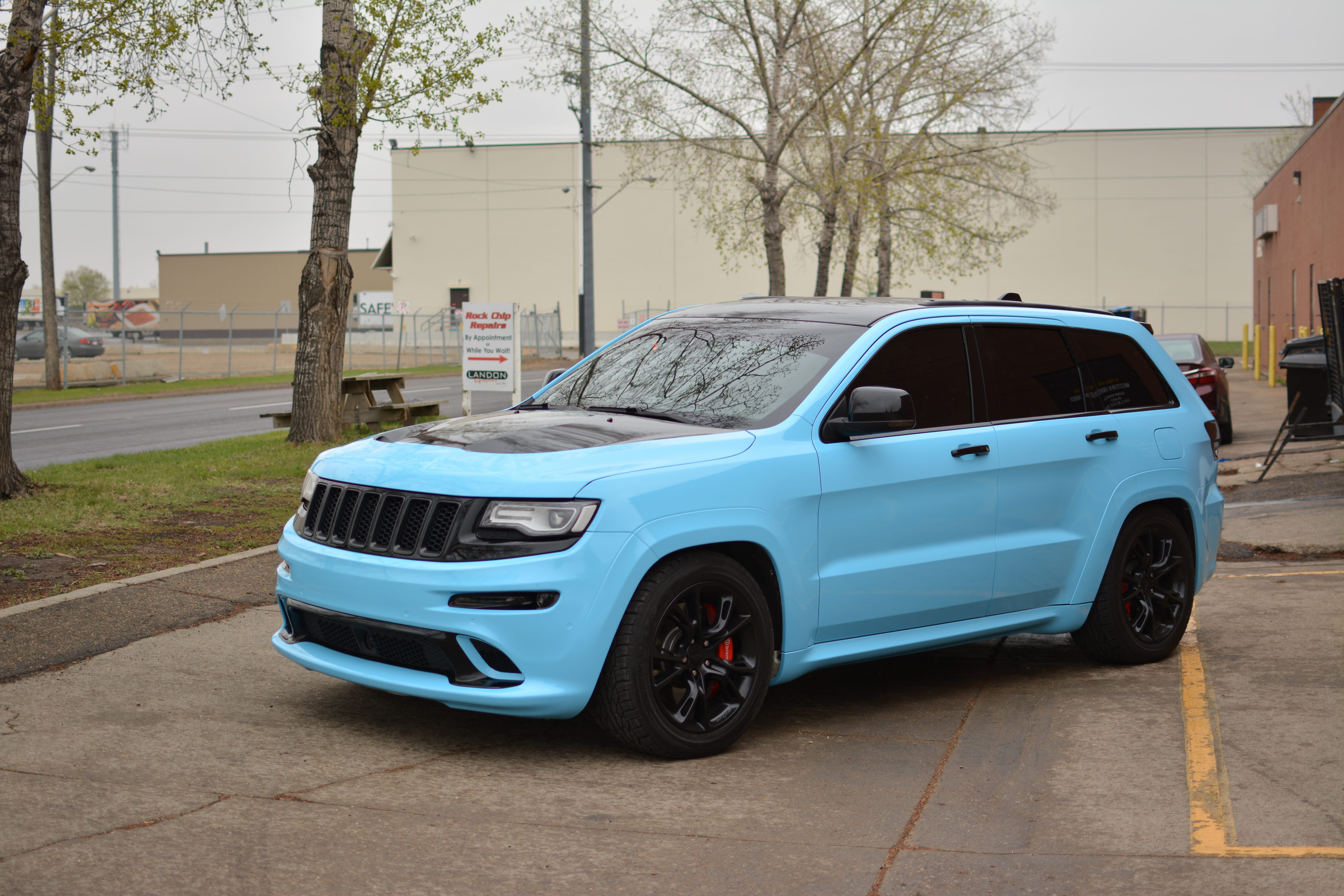Jeep SRT8 wrapped in 3M Sky Blue.