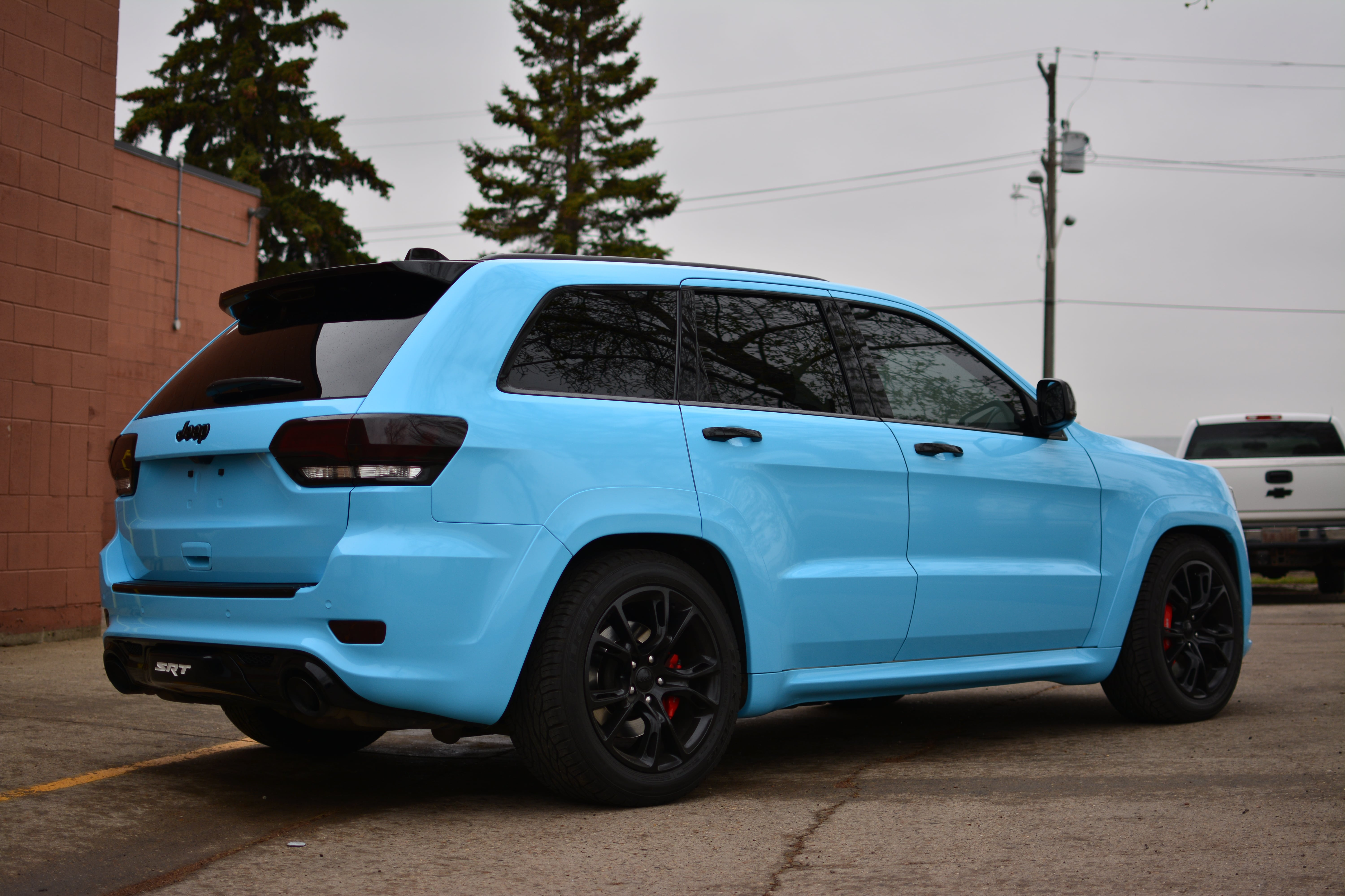 Jeep SRT8 3M Sky Blue, taken from behind.