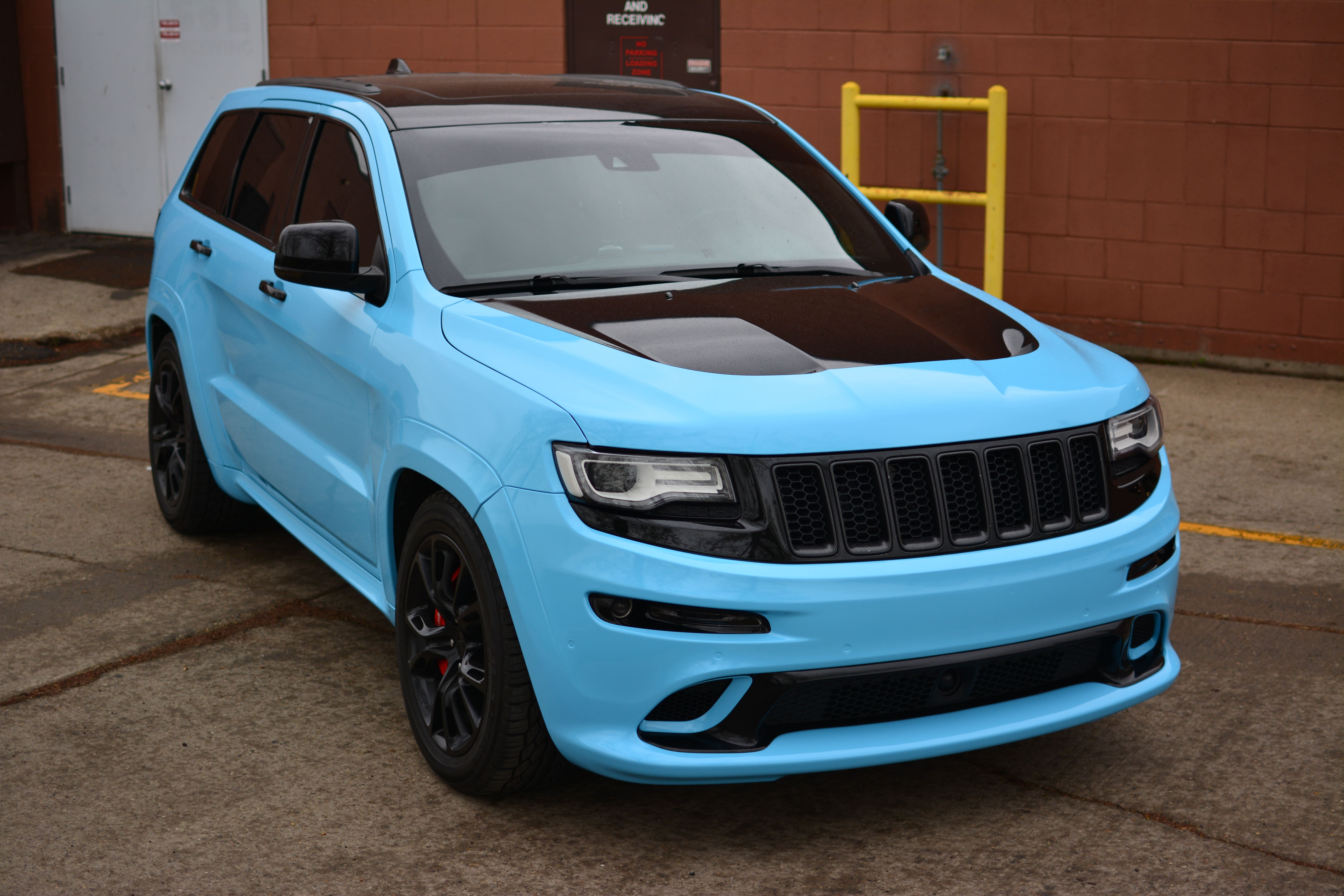 Jeep SRT8 wrapped in 3M Gloss Sky Blue.