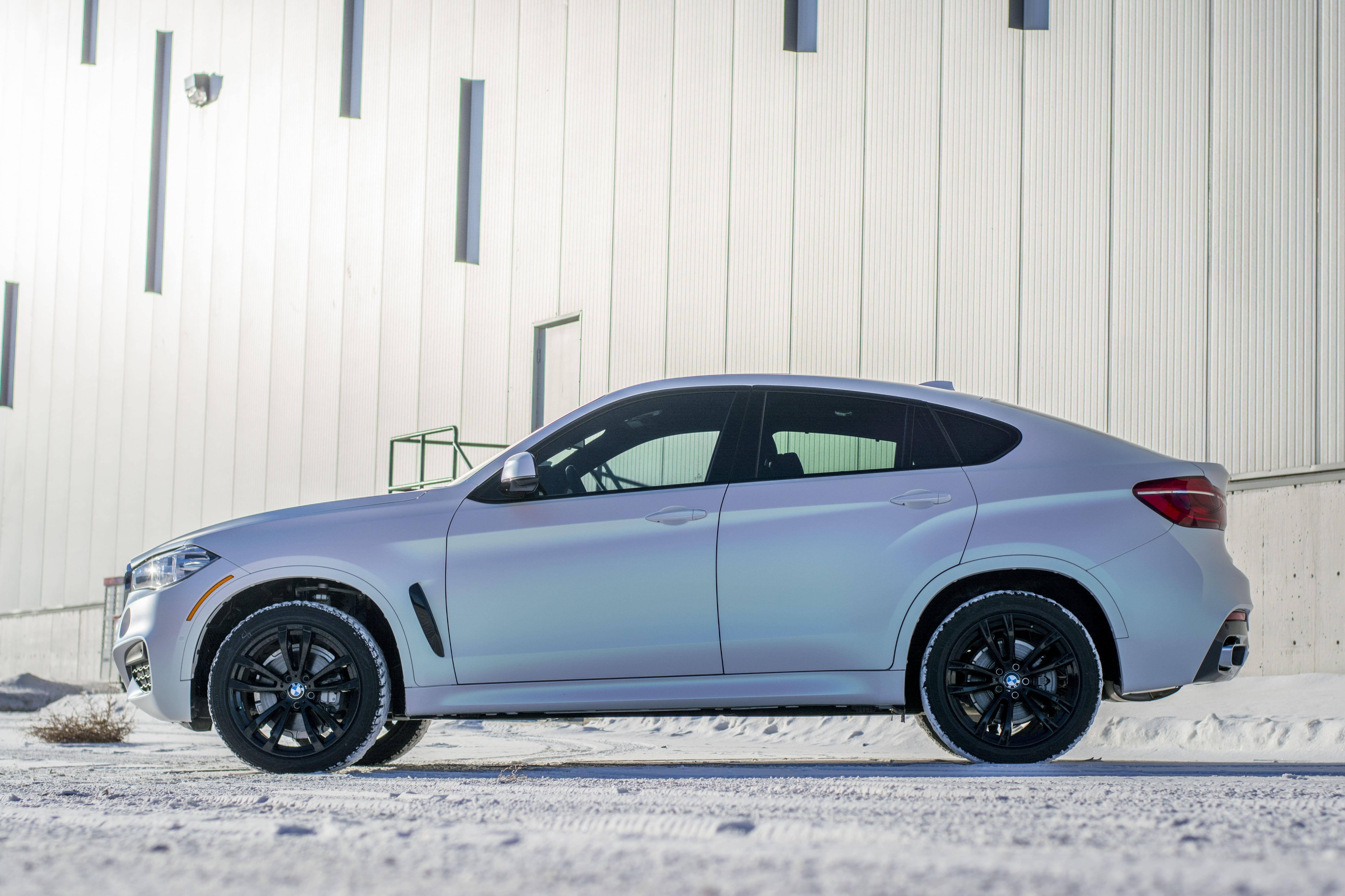 BMW X8 wrapped in KPMF Matte Aurora Pearl from side.