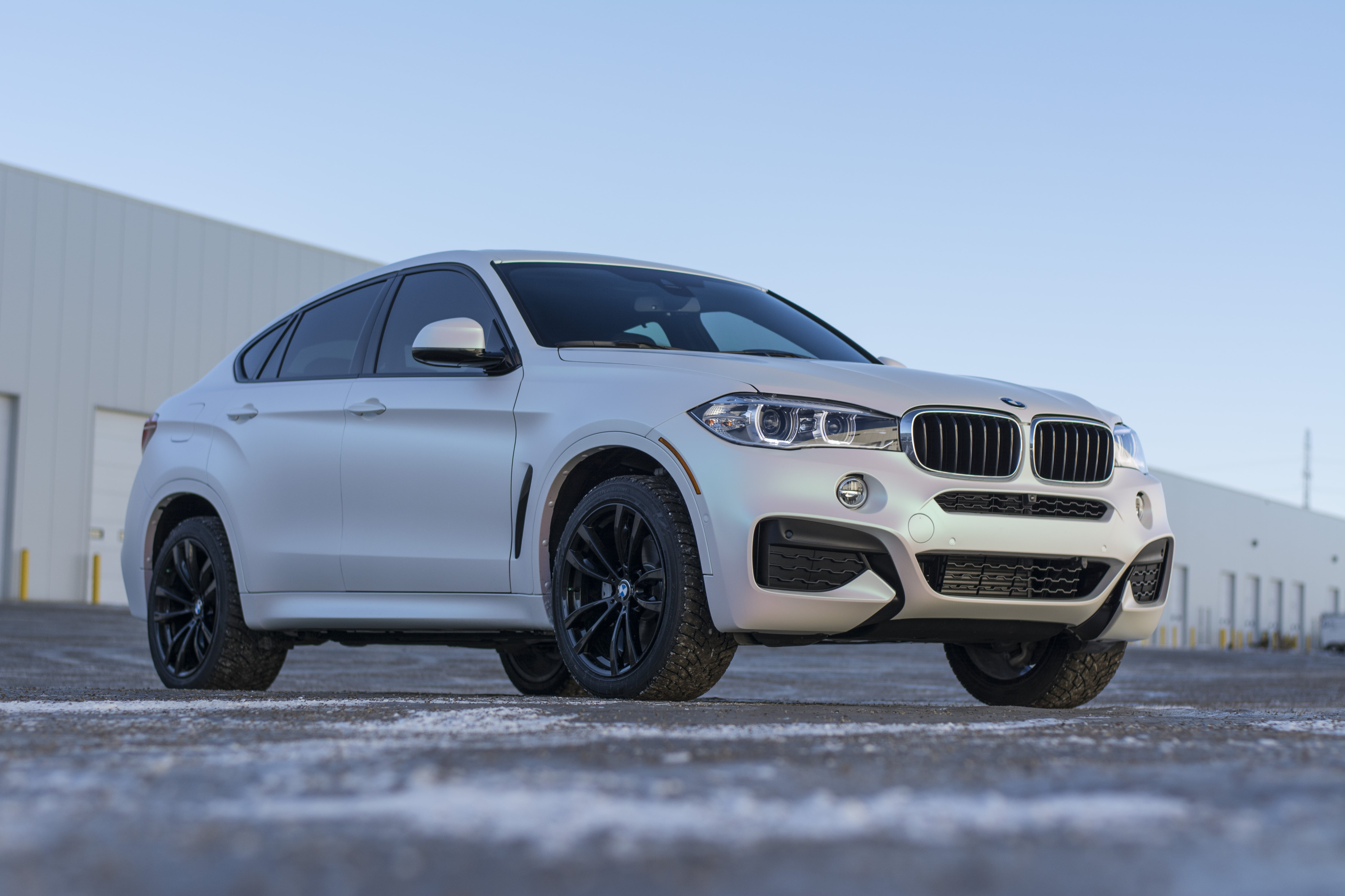 BMW X8 wrapped in KPMF Matte Aurora Pearl from front left.