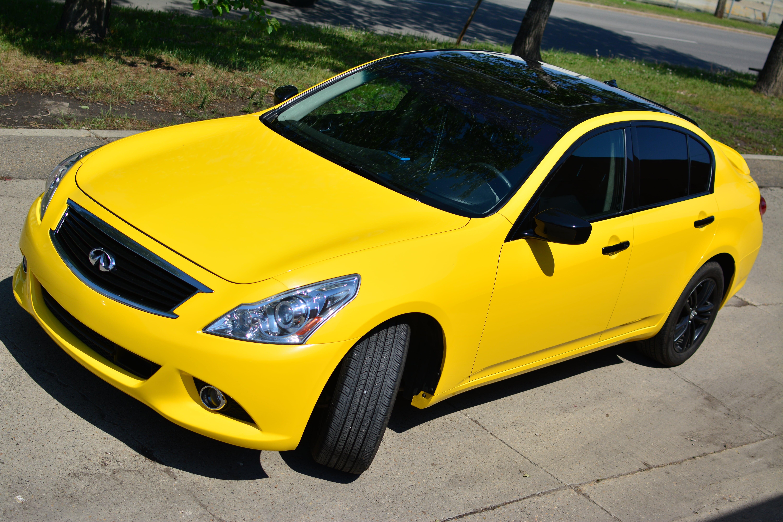 Infiniti G37 wrapped in 3M Gloss Yellow.