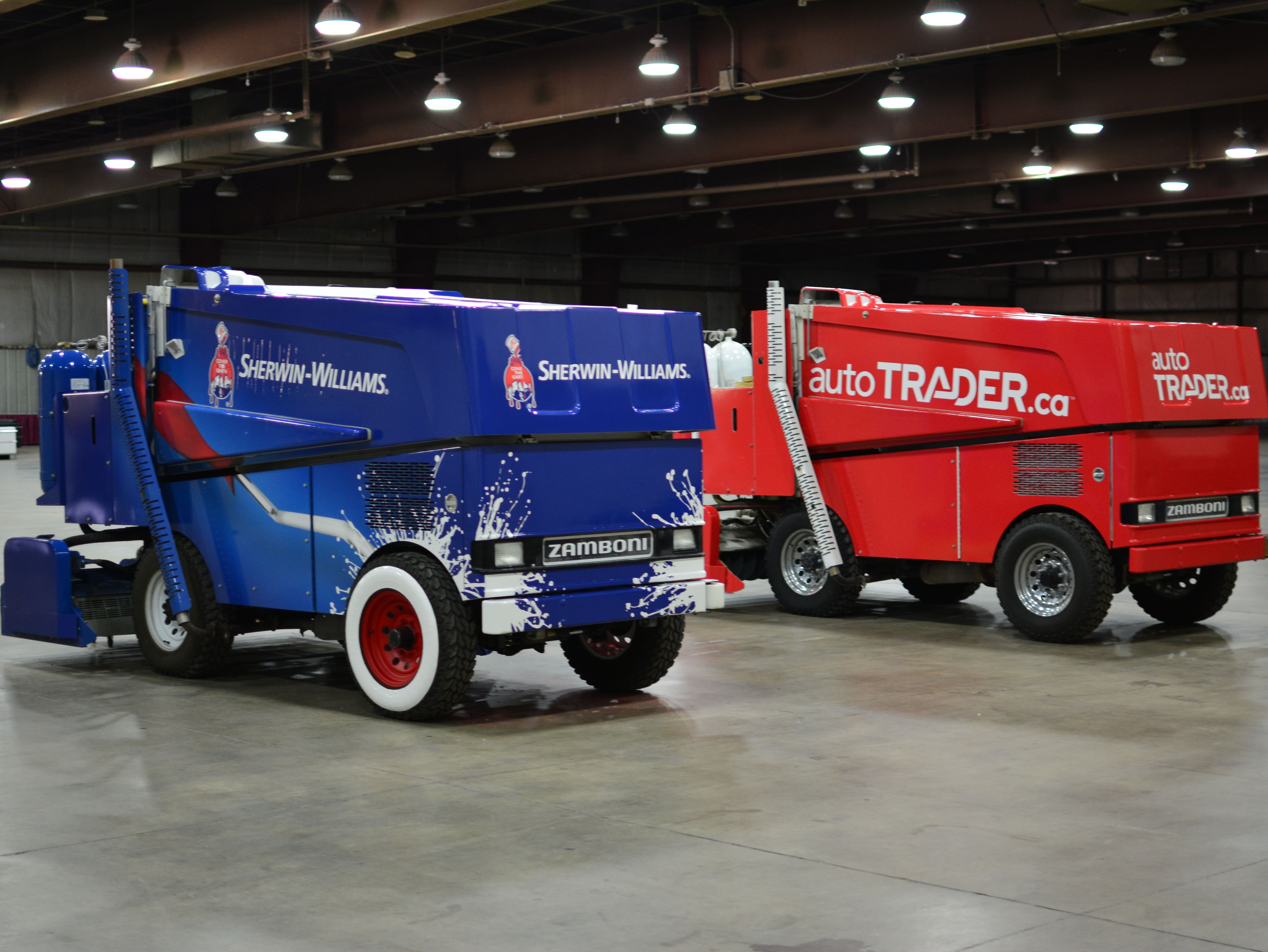 2 Zambonis with complete wraps.
