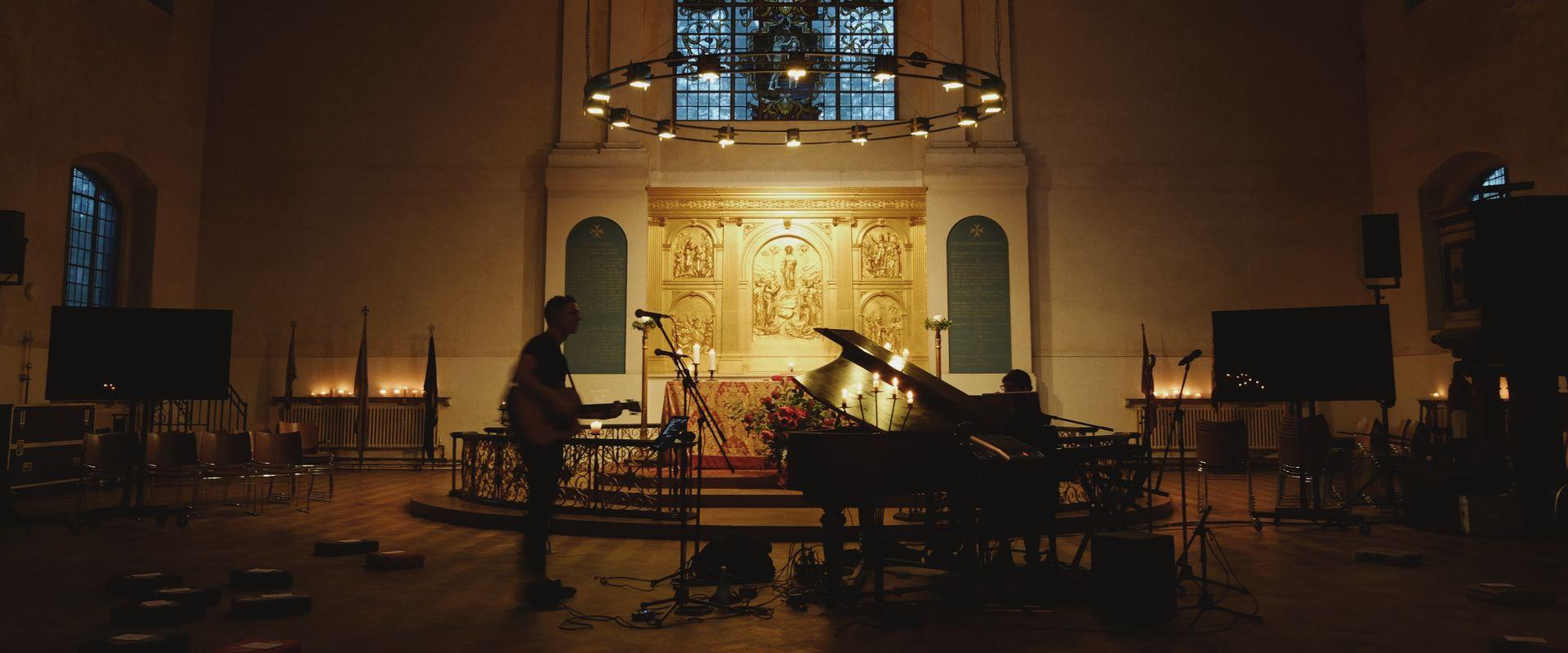 musicians playing in dark church