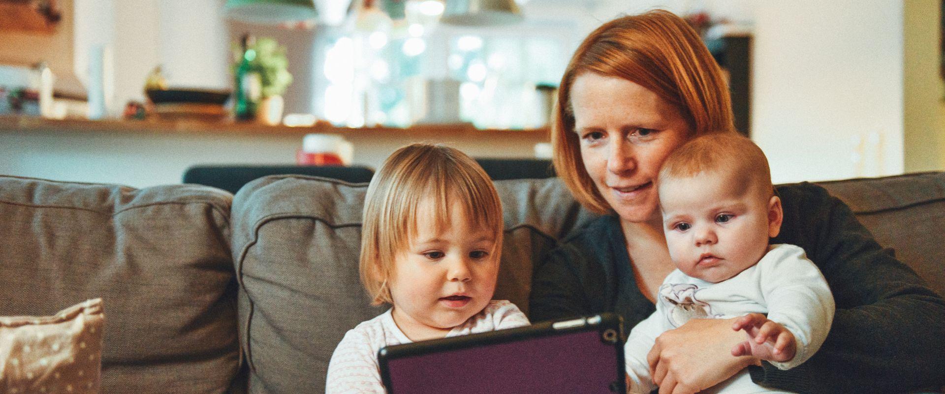 mom with babies and iPad