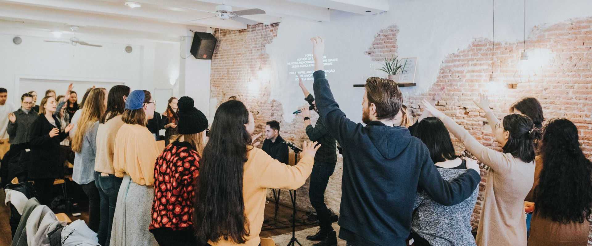 young people worshipping