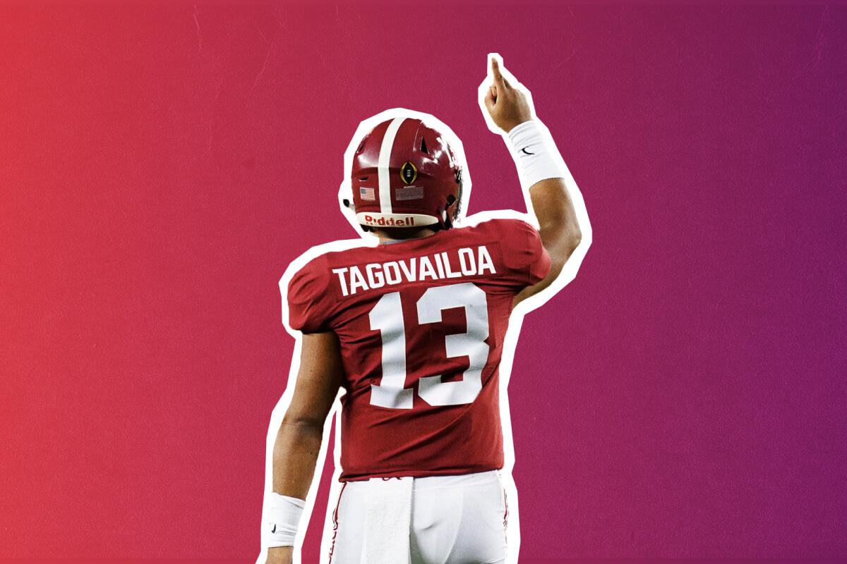 Tua Tagovailoa points to the sky during a Alabama Crimson Tide match