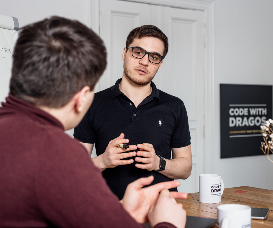 Apply for a free consultation call at CodeWithDragos.