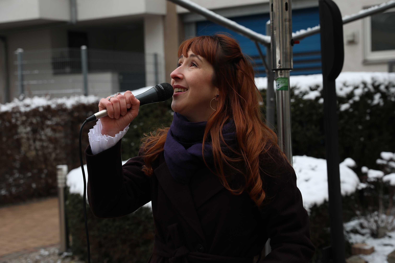 A singer singing outside an elderly home