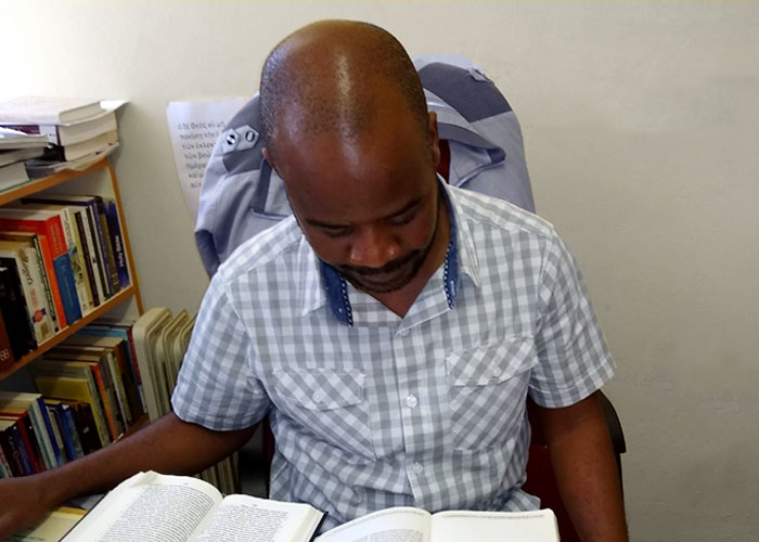A member of ICBM's faculty studying the Bible