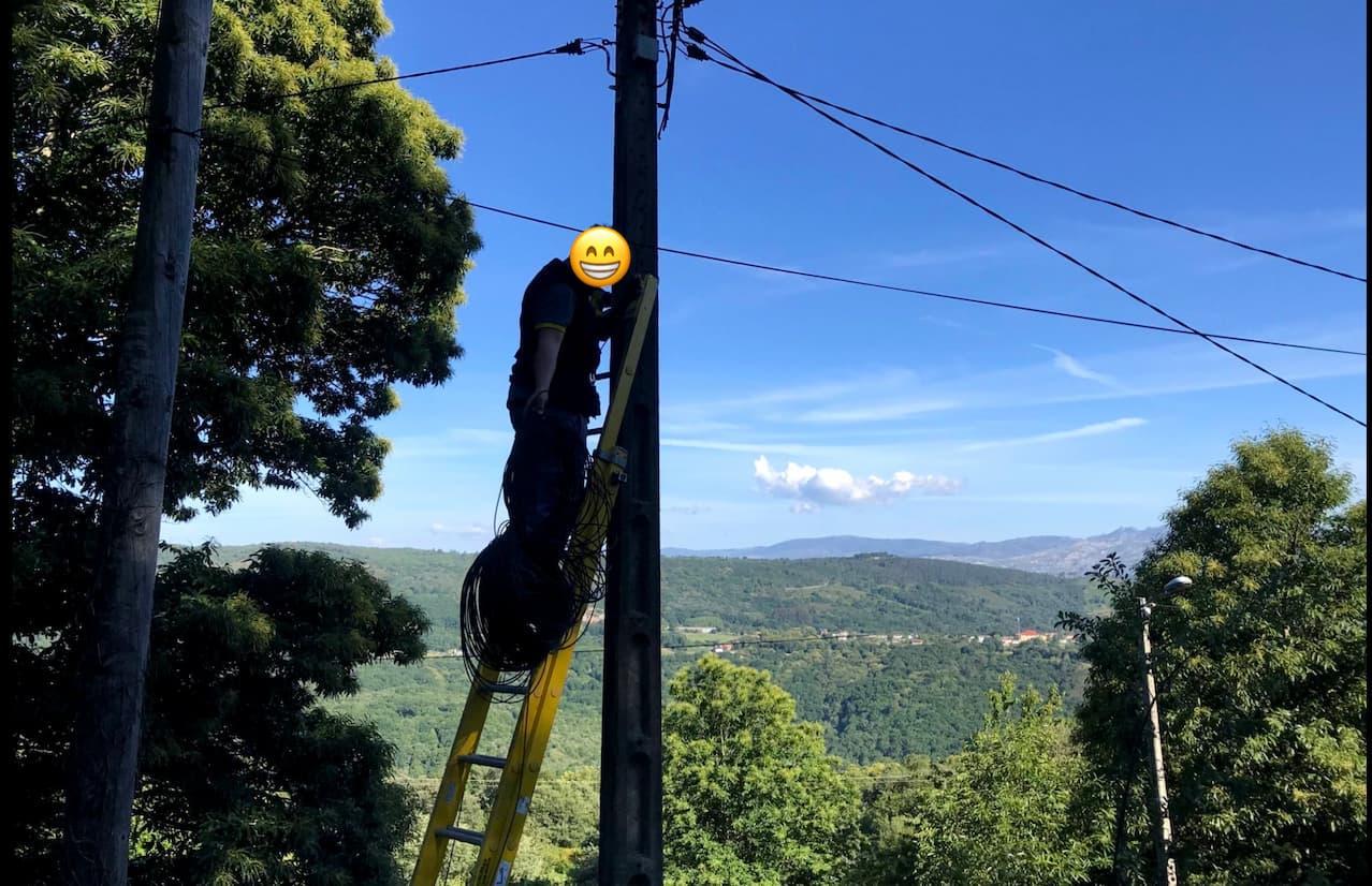 A man deploying fiber optics cables in Senderiz village