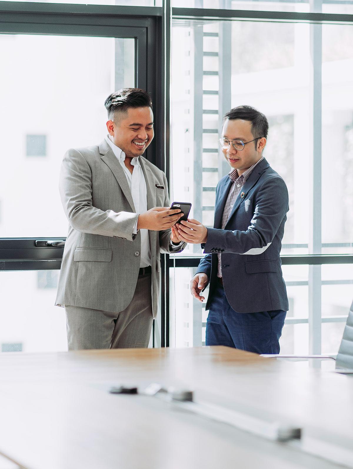 2 business men in a boardroom