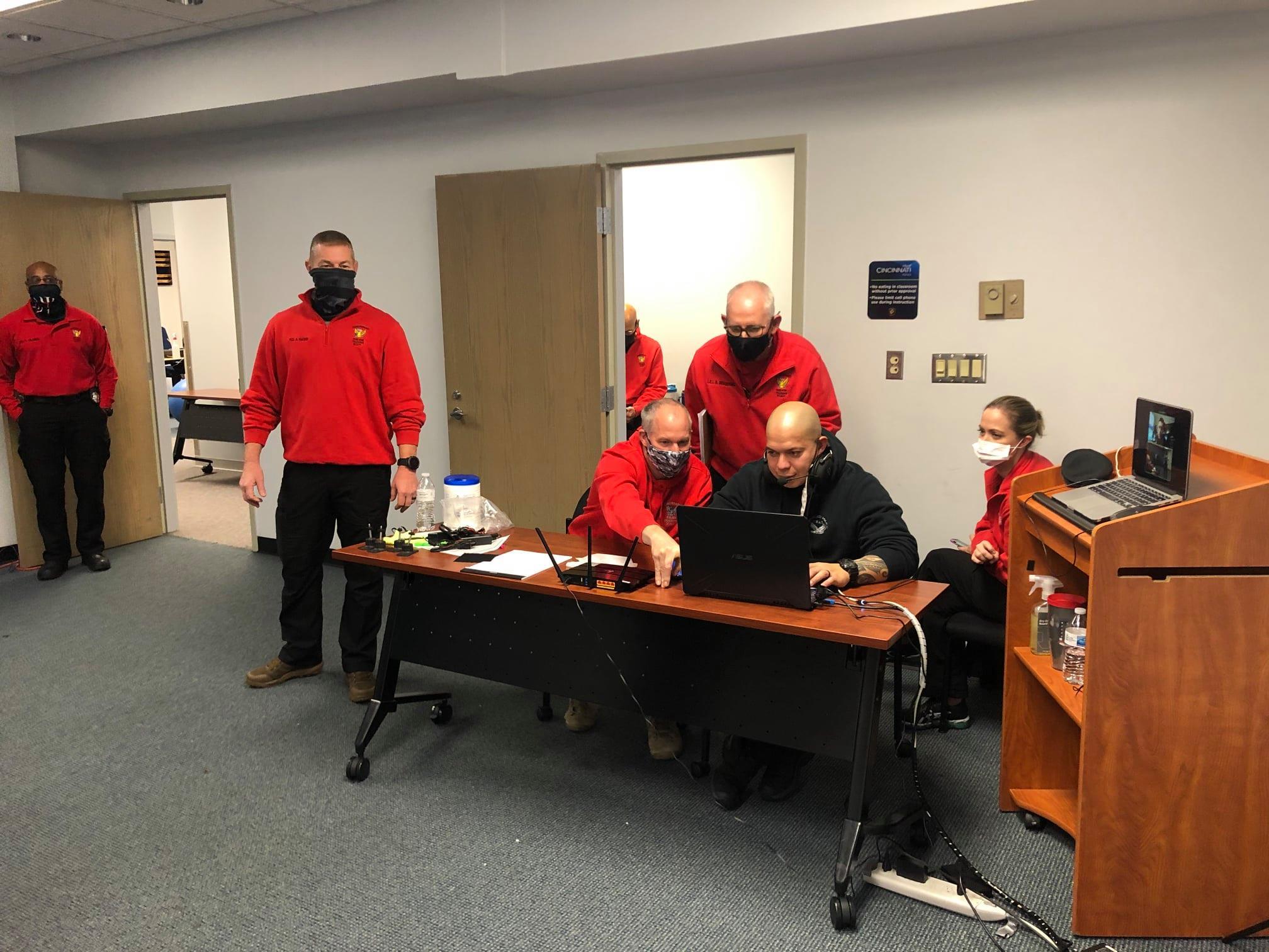 Cincinnati Police Academy Instructors Operating the Apex Officer Simulator