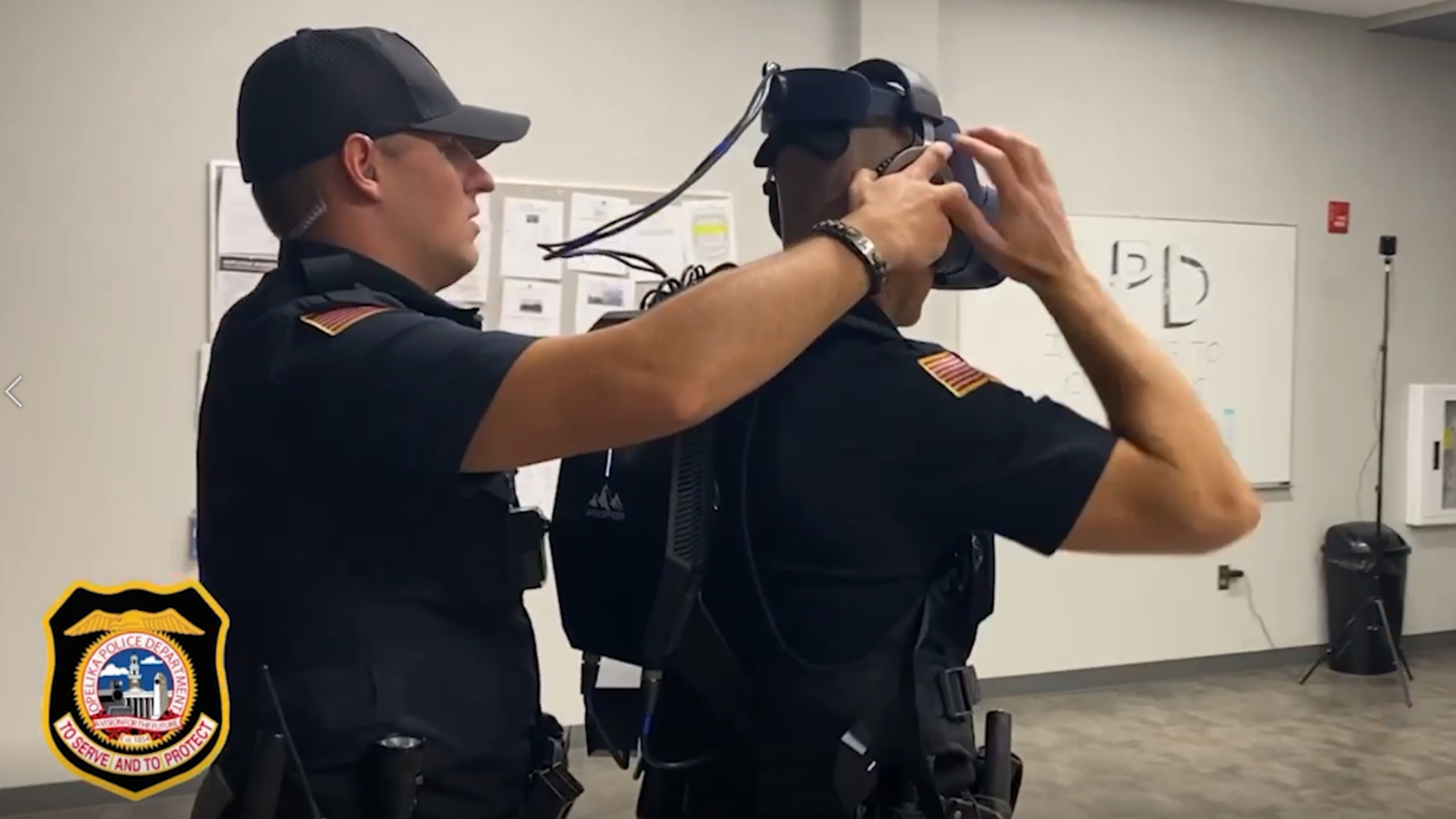 Opelika Police Officer Straps into the Apex Officer VR Training System Before a Training Scenario