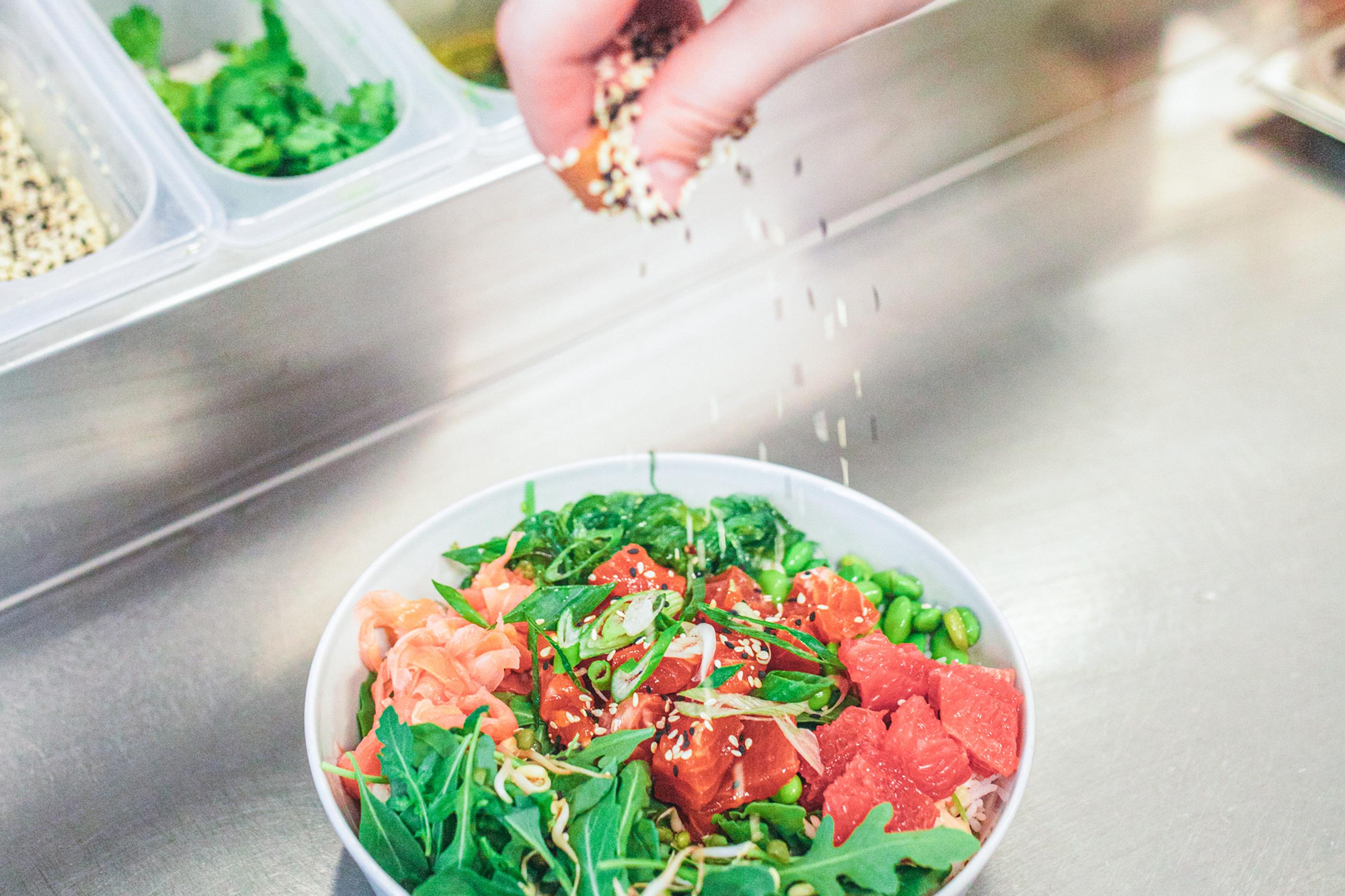 Poke bowl making fingers ingredients green salad