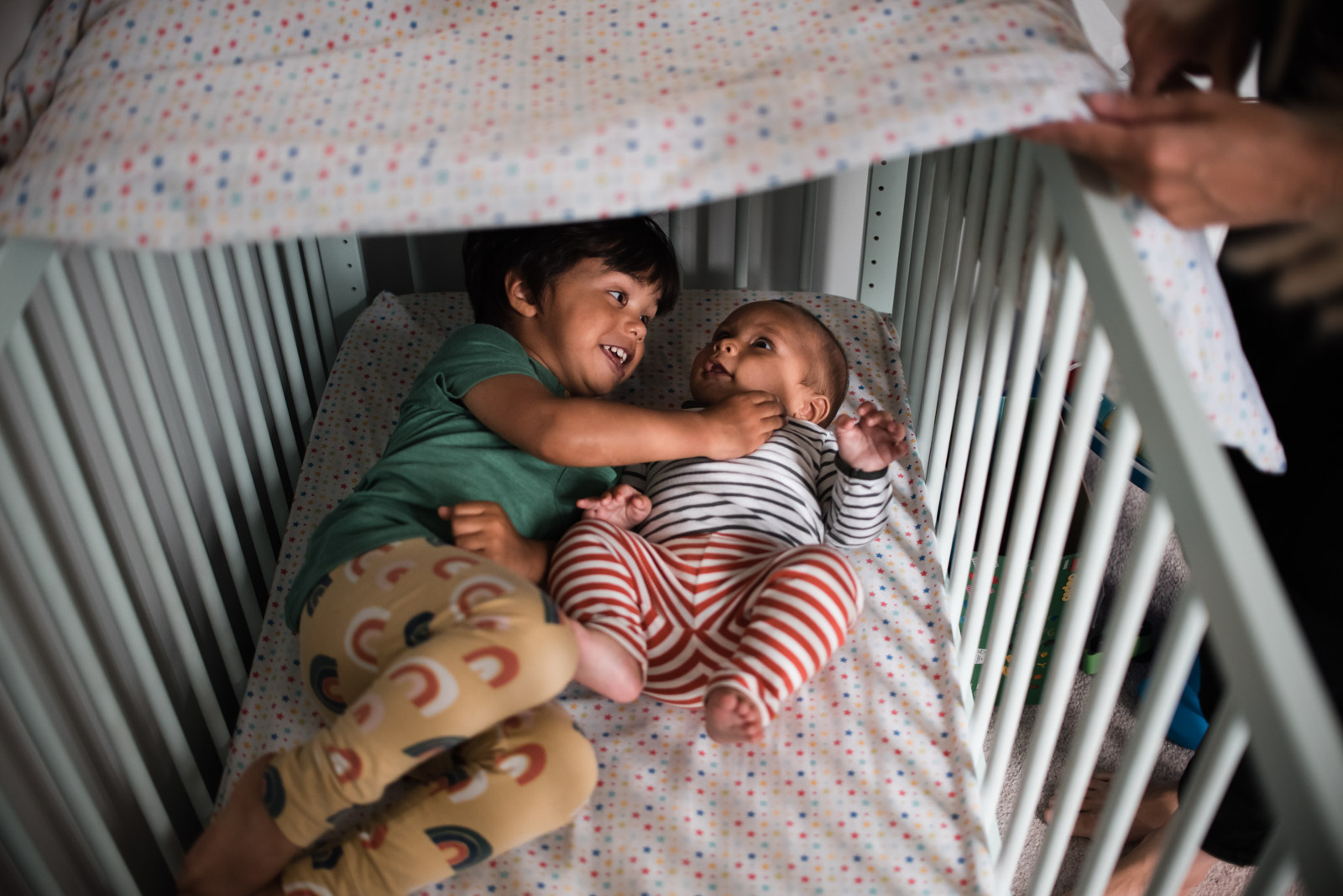 London family photographer The Ginger Collective, children in the cot