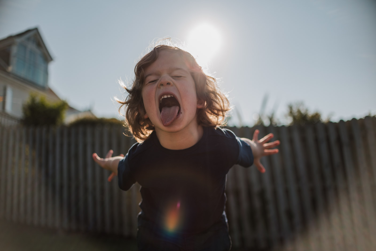 Best family photographer in Berkshire, boy smiling in the sun