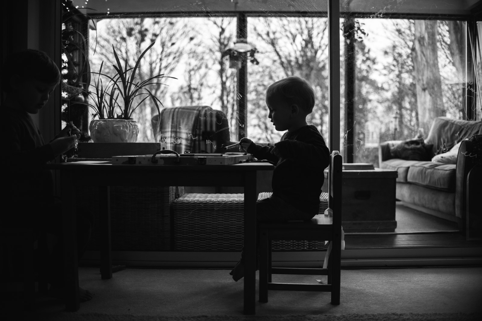 Natural Hampshire family photographer of boy drawing by The Ginger Collective