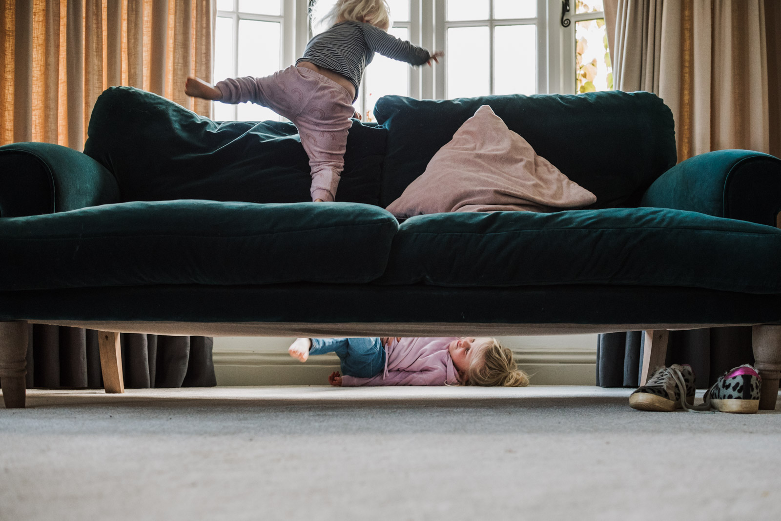 Gorgeous natural family photography by The Ginger Collective of children playing hide and seek