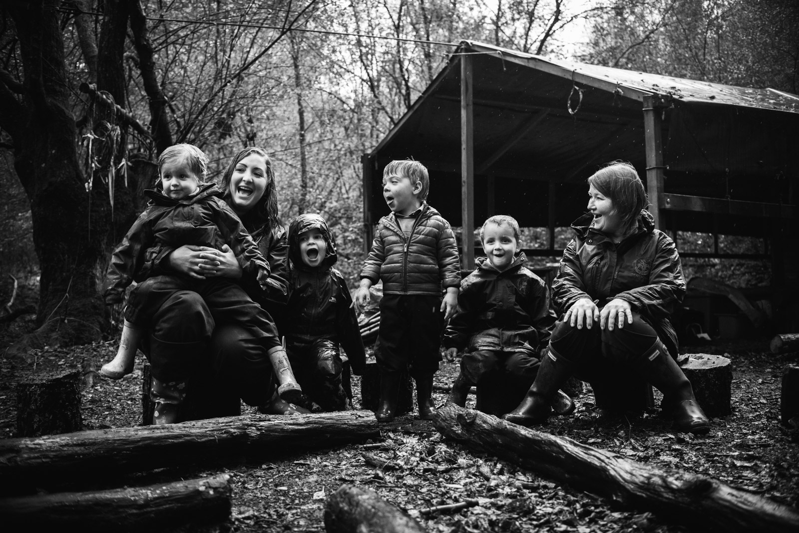 Forest school photographer of children in the woods at Berkshire school Thorngrove