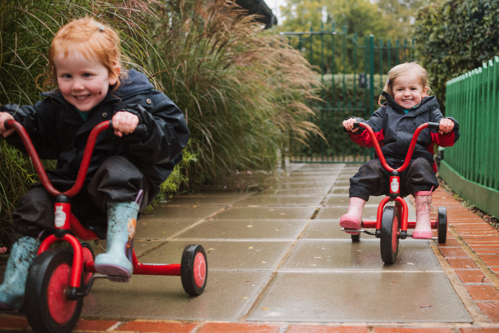 Natural brand photography by The Ginger Collective of girls riding bikes at Berkshire school Thorngrove