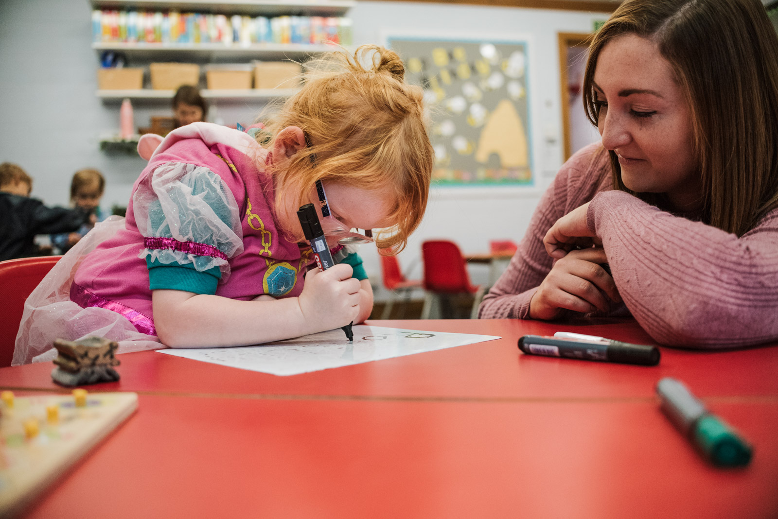 Natural school photography of girl writing by The Ginger Collective at Berkshire school Thorngrove