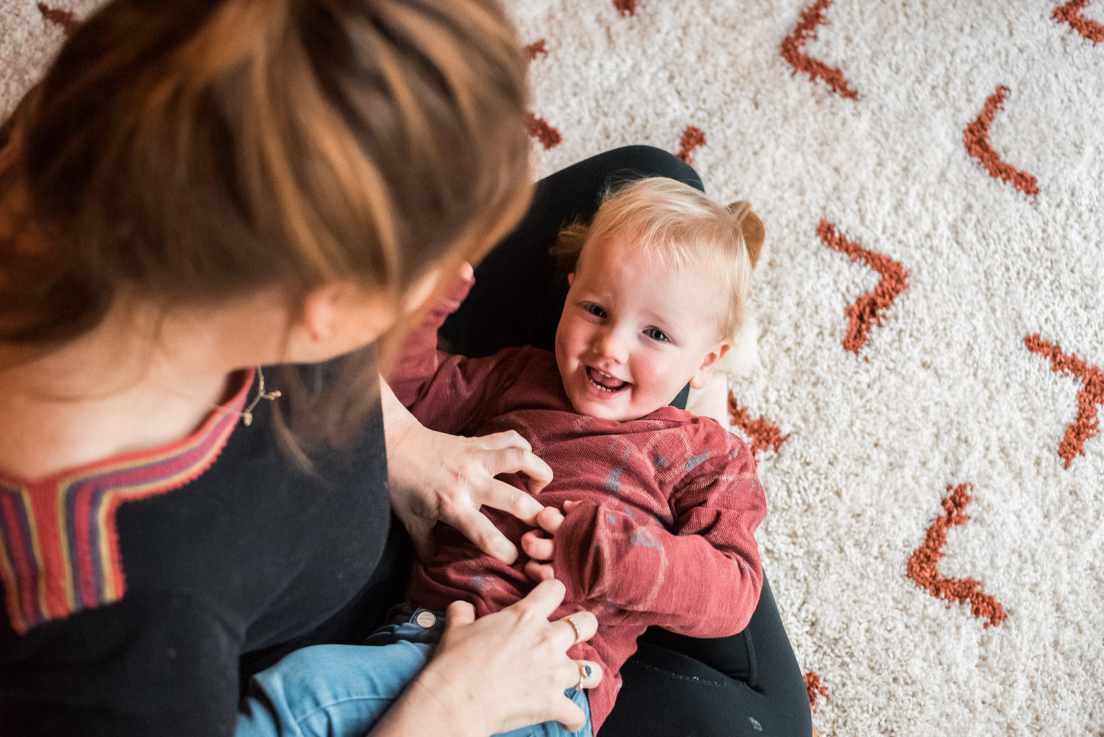 Documentary family photography, boy being tickled by Mum, The Ginger Collective photography