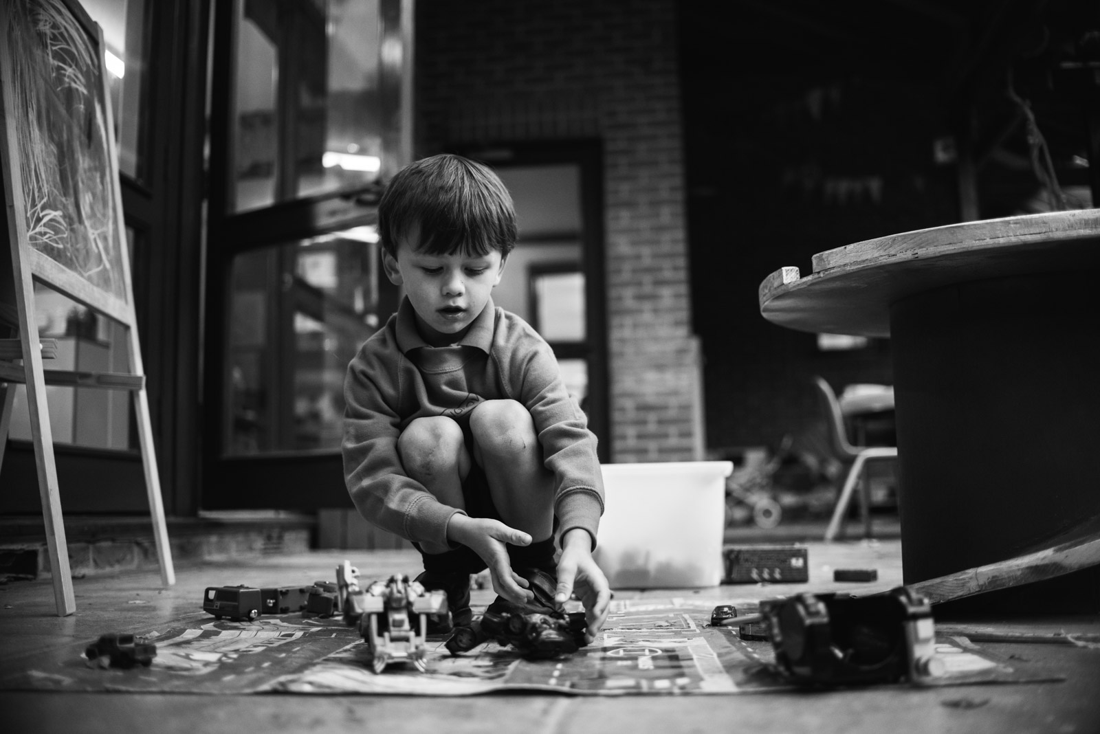 Relaxed rand photograph by The Ginger Collective of a boy playing with cars at Berkshire school Thorngrove