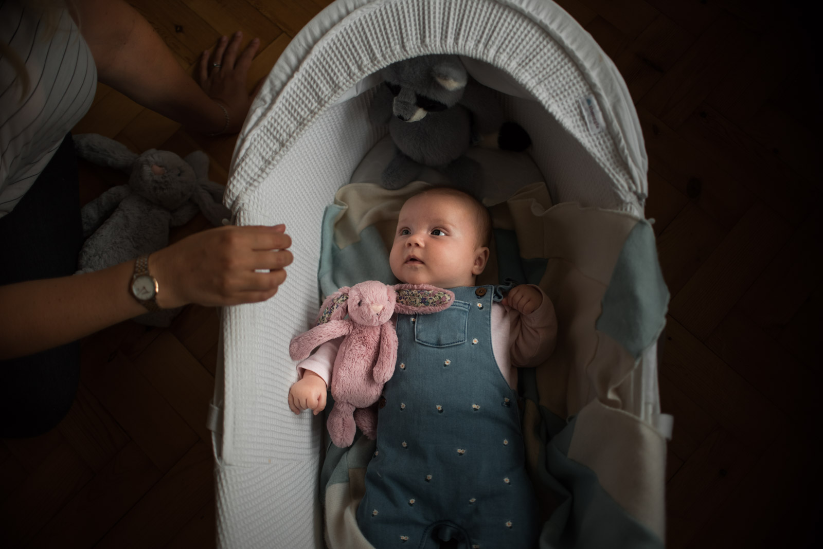 Unposed newborn photography, Mum looking at baby in cot, The Ginger Collective Photography