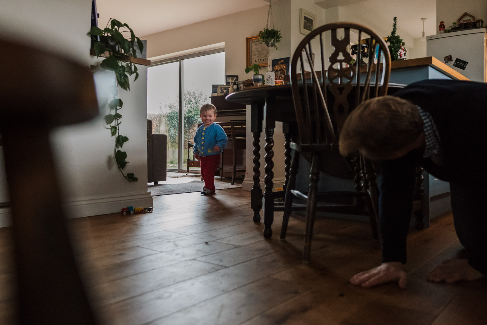 Natural family photography, boy playing games with Dad, taken by The Ginger Collective Photography