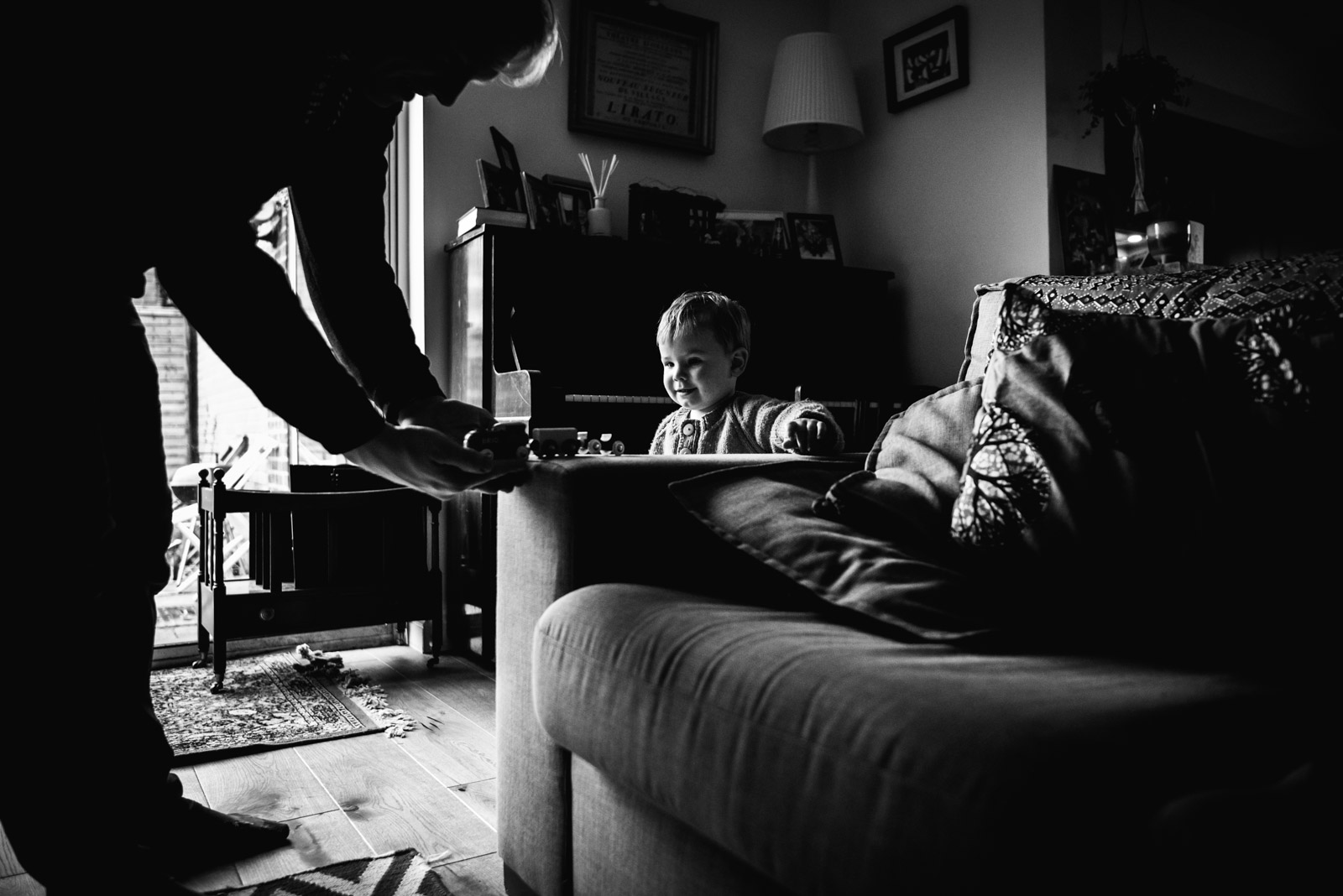 Emotive family photography, boy playing with train, taken by Berkshire based The Ginger Collective photography