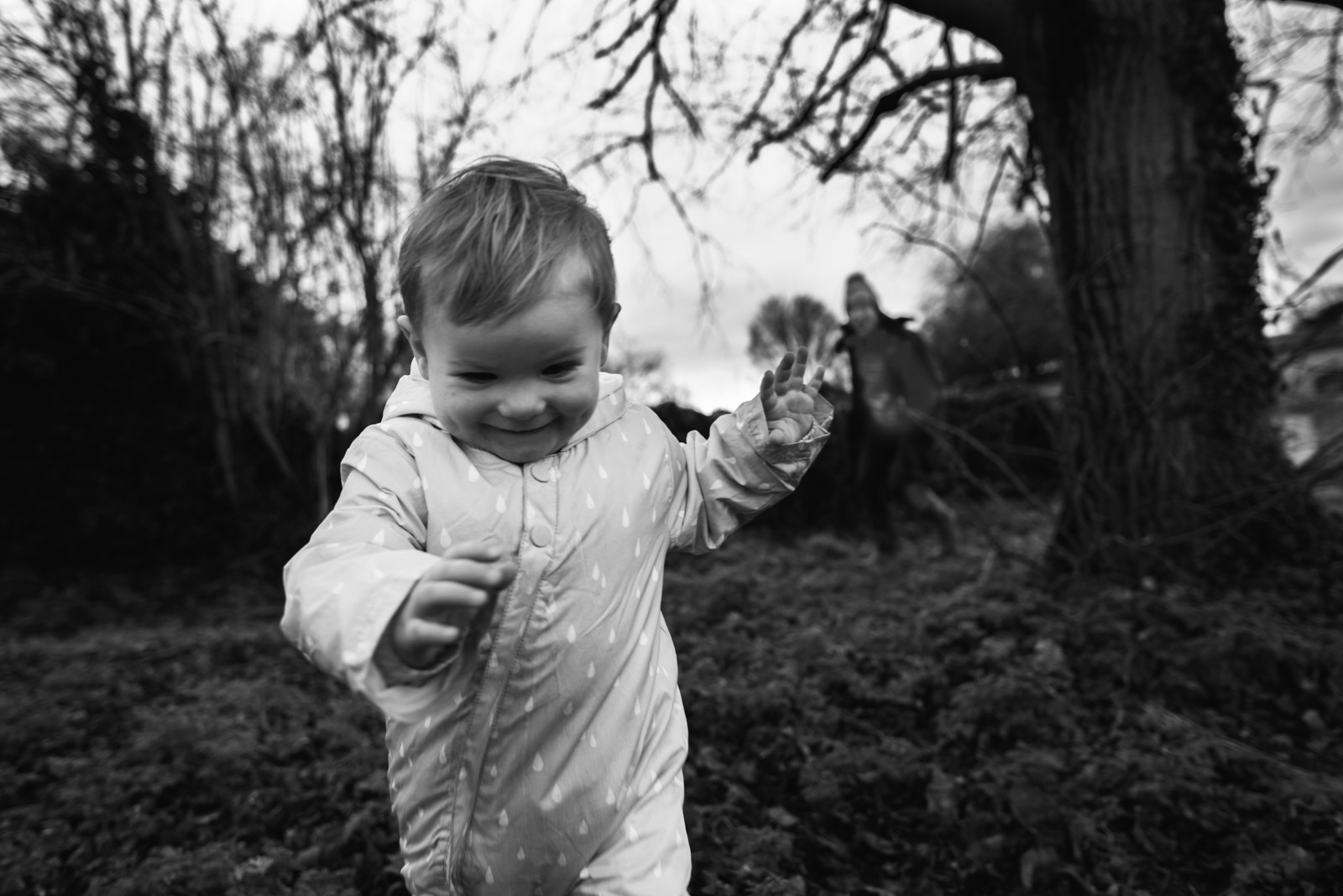 Natural family photography, boy playing hide and seek with his Mum, The Ginger Collective photography
