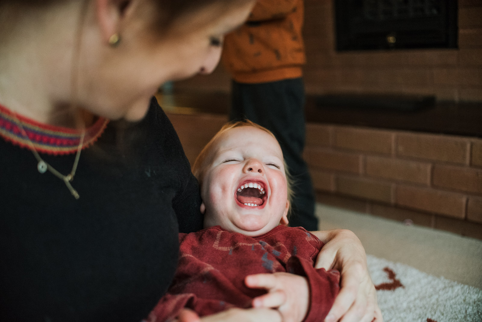 Unposed family photography by Berkshire based The Ginger Collective, boy laughing
