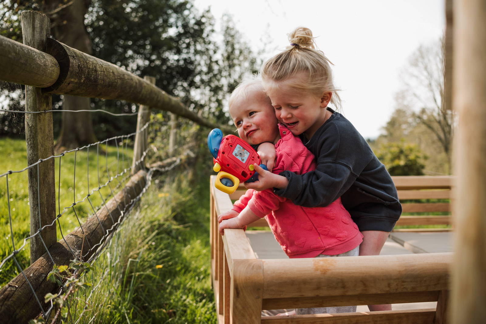 Natural family photography, siblings hugging, The Ginger Collective Photography