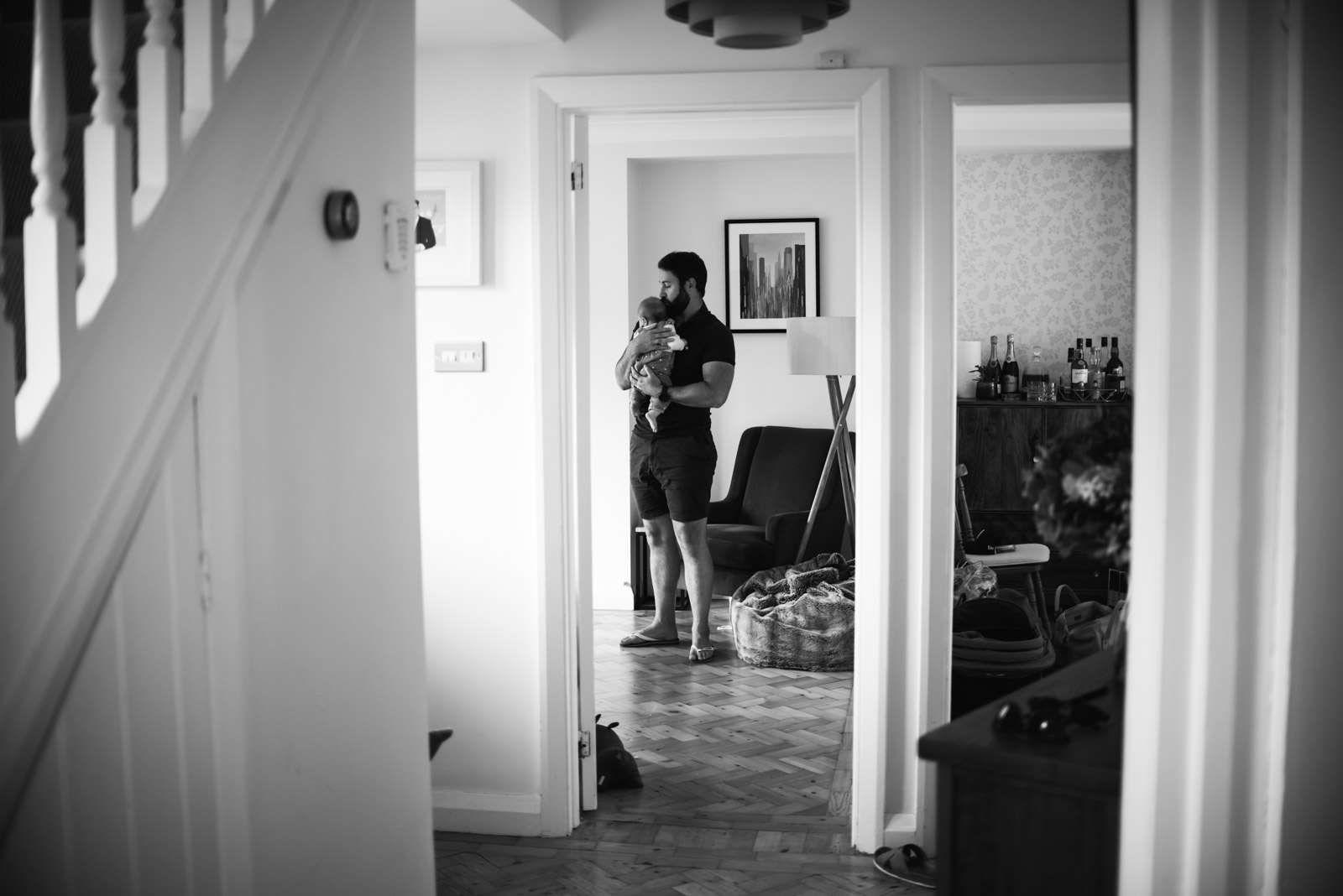 Documentary newborn photography, Dad walking with baby, The Ginger Collective Photography