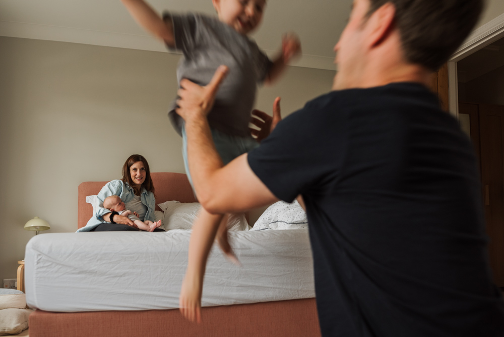 Relaxed surrey family photography by The Ginger Collective - boy jumping off bed