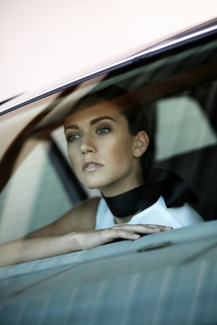 Commercial shot of Jessamine staring our of car window.