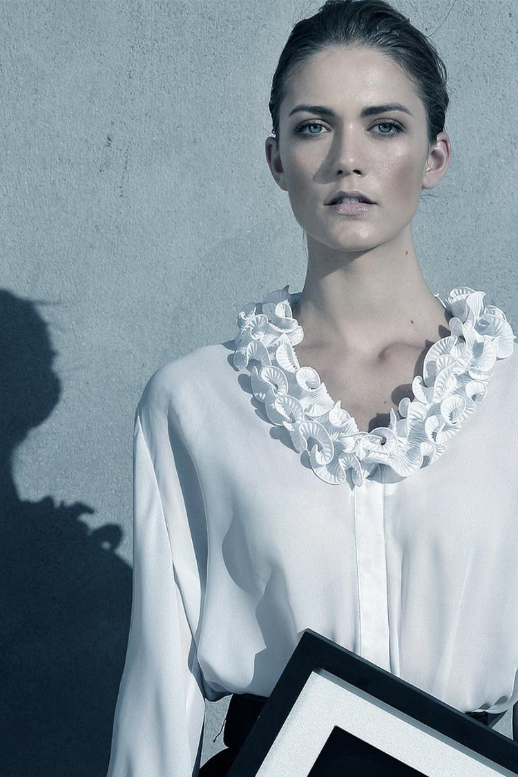 Model shot of Jessamine in white blouse