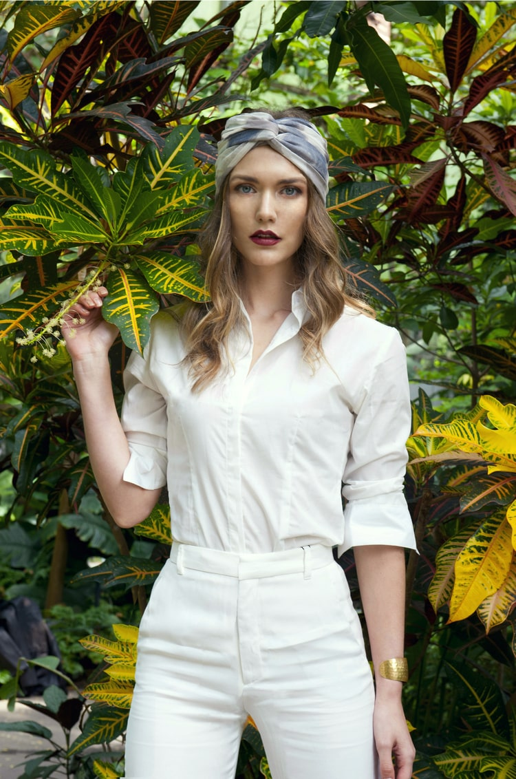 Jessamine in white outfit in the jungle