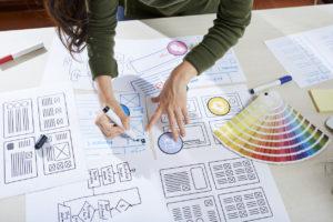 woman creating logo design for company