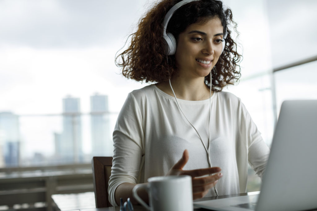 Young woman attending virtual events in her office