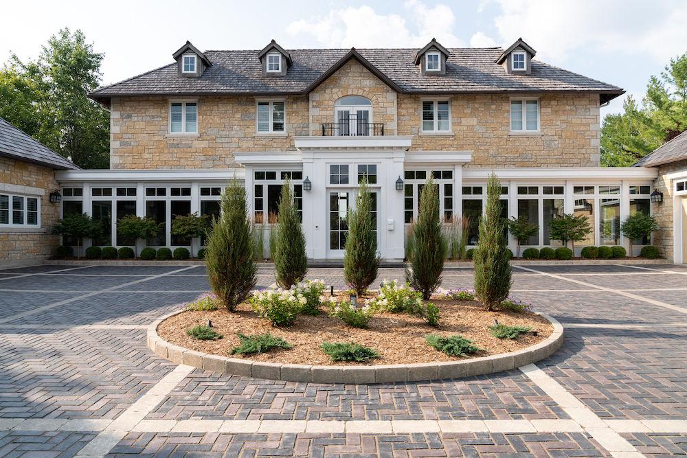 Large Interlock Circular Driveway Estate Home.