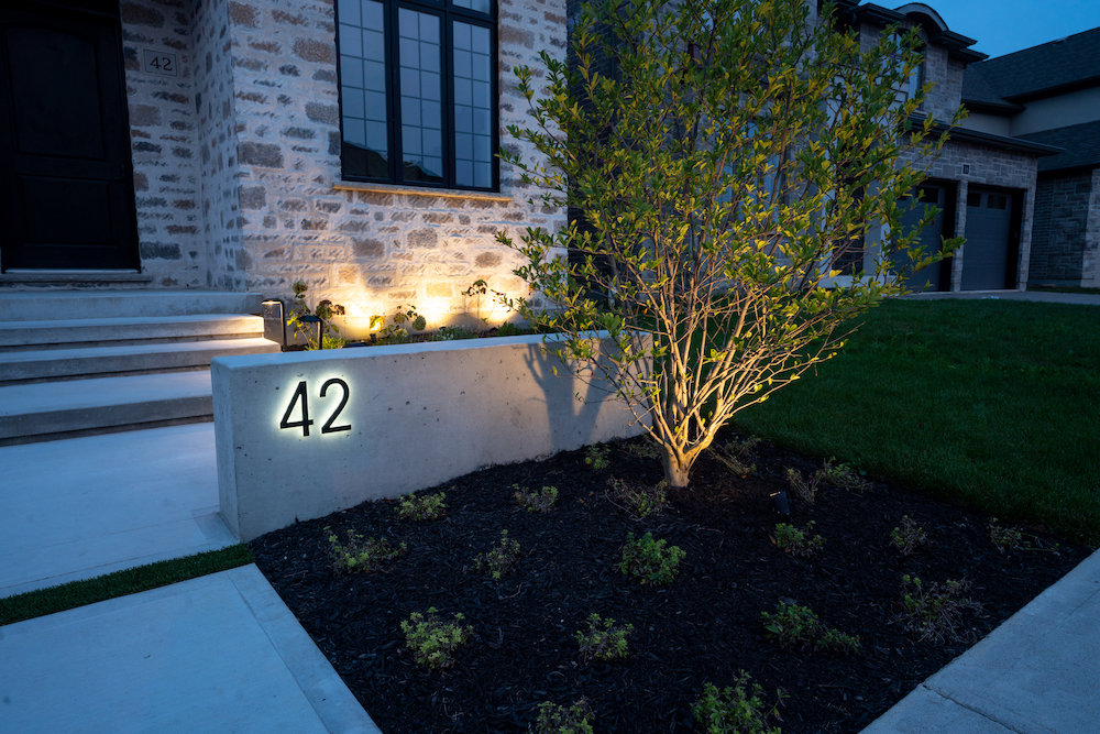 Modern Concrete Front Walkway with Landscape Lighting.
