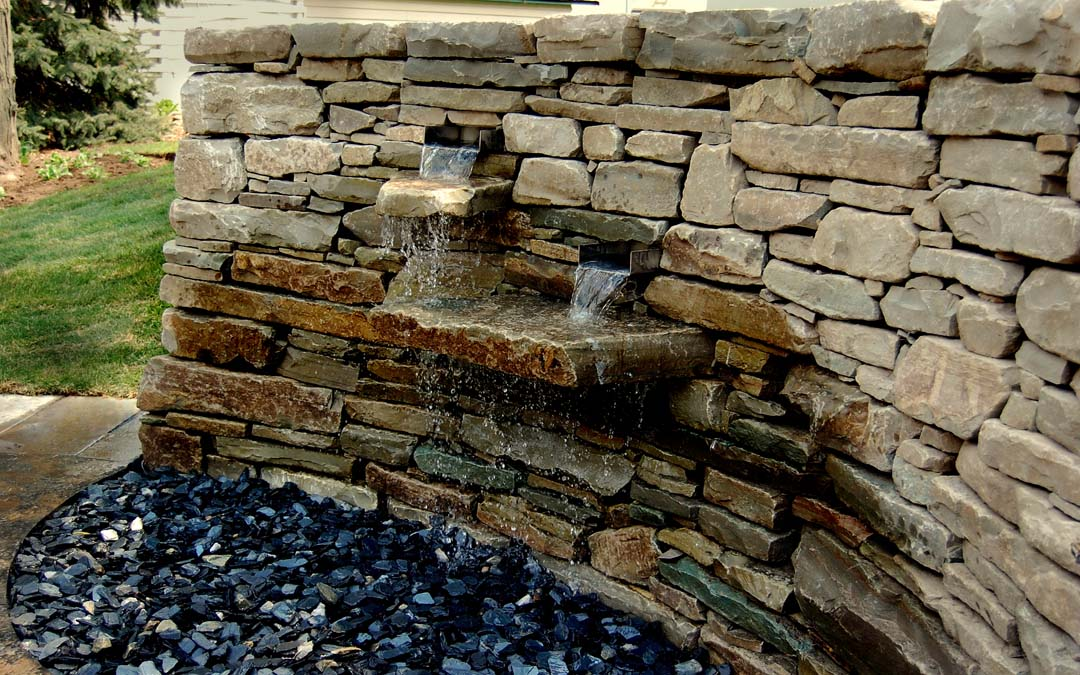 A water feature built into a drystone wall.