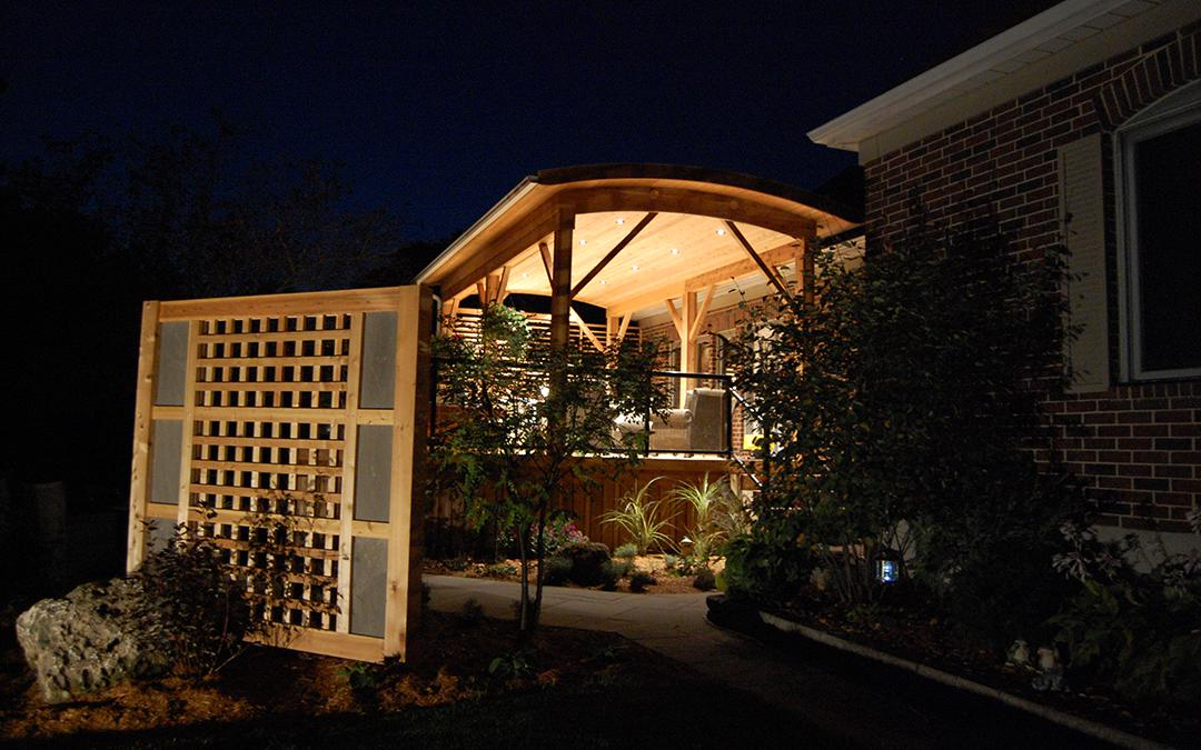 A garden with landscape lighting and a flagstone walkway.